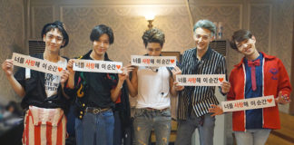 shinee with hand banner